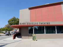 Kirk Douglas Theater in Culver City. CULVER CITY, CA - MARCH 16: Ads run on screens of Fashion Show plaza area featuring stores with the Encore in the distance Stock Images