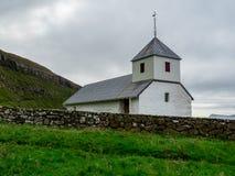 Kirkjubøur. Old and white church