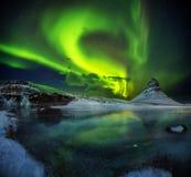 Kirkjufell mountain with beautiful aurora borealis and frozen wa Royalty Free Stock Photo