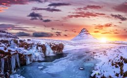 Kirkjufell mountain with frozen water falls in winter, Iceland. royalty free stock photo