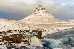 Kirkjufell Mountain in the Snaefellsnes Peninsula at winter. Waterfall and landscape in Iceland royalty free stock images