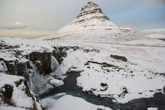 Kirkjufell mountain with waterfalls at winter, Iceland royalty free stock image