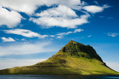 Kirkjufell mountain, West Iceland. Kirkjufell Mountain, Grundarfjorour, West Iceland. It is one of the most beautiful mountain in Iceland. A hiking path around royalty free stock photography