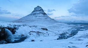 The Kirkjufell mountain in winter at twilight. Stock Photography