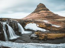 Kirkjufellsfoss and Kirkjufell Icelandic, Church mountain , a 463 m high mountain on the north coast of Iceland`s stock photo