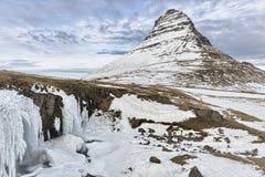 The Kirkjufellsfoss and Kirkjufell mountain in Iceland Stock Photos