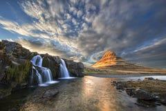 Kirkjufellsfoss and Kirkjufells Iceland at Sunset. The waterfalls Kirkjufellsfoss and Mount Kirkjufells in Iceland at Sunset Stock Image