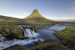 Kirkjufellsfoss waterfall with Kirkjufell mountain Iceland. Amazing sunrise the top of Kirkjufellsfoss waterfall with Kirkjufell mountain in the background on Royalty Free Stock Photos