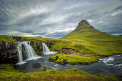 Kirkjufellsfoss waterfall and Kirkjufell mountain, Iceland Royalty Free Stock Images