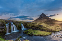 Kirkjufellsfoss waterfall and kirkjufell mountain in the morning Stock Photo