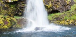 Kirkjufellsfoss waterfall near the Kirkjufell mountain Stock Photography