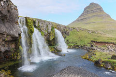 Kirkjufellsfoss waterfall near the Kirkjufell mountain Royalty Free Stock Photos