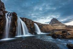 Kirkjufellsfoss  waterfalls and kirkjufell mountain in the morni Royalty Free Stock Photo