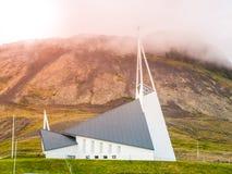 KIRKJUTUN, OLAFSVIK, ICELAND - JUNE 25, 2014: Modern church Olafsvikurkirkja Olafsvik Kirkja near Enni mountain. The. Church was consecrated in 1967 Royalty Free Stock Photo