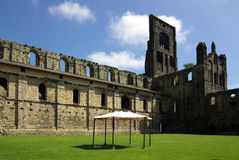 Kirkstall Abbey, Leeds, Britain. LEEDS, YORKSHIRE, UK - June 6, 2013: Kirkstall Abbey in summer day Royalty Free Stock Image