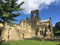 Kirkstall Abbey in Leeds 15. Kirkstall Abbey is a ruined Cistercian monastery in Kirkstall, north-west of Leeds city centre in West Yorkshire, England. It is set Royalty Free Stock Photo