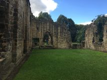 Kirkstall Abbey in Leeds 20. Kirkstall Abbey is a ruined Cistercian monastery in Kirkstall, north-west of Leeds city centre in West Yorkshire, England. It is set Royalty Free Stock Image