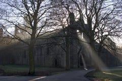 Kirkstall Abbey, Leeds, West Yorkshire. Sun rays through mist, Kirkstall Abbey, Leeds, West Yorkshire Royalty Free Stock Image