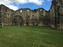 Kirkstall Abbey in Leeds 16. Kirkstall Abbey is a ruined Cistercian monastery in Kirkstall, north-west of Leeds city centre in West Yorkshire, England. It is set Royalty Free Stock Image