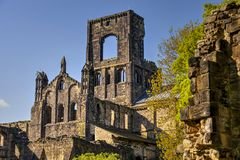 Medieval Kirkstall Abbey near Leeds. Kirkstall Abbey is a ruined Cistercian monastery in Kirkstall, north-west of Leeds city centre in West Yorkshire, England Royalty Free Stock Photos