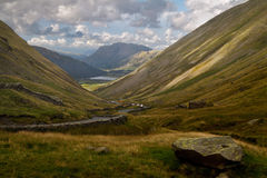 Kirkstone Pass. The Kirkstone Pass descends steeply towards Brothers Water in the Lake District in Cumbria, England Royalty Free Stock Images