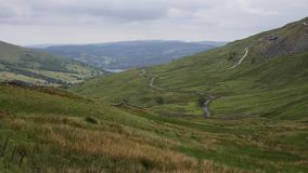 Kirkstone Pass view towards Grasmere Lake District England UK with countryside in HDR stock video footage