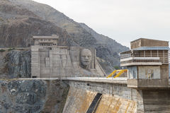 Kirov reservoir dam. Built 1965 - 1975, Lenin`s face on the ad royalty free stock photos