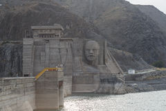 Kirov reservoir dam. Built 1965 - 1975, Lenin`s face on the ad stock photos