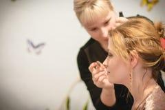 Master making make up for girl bride. Kirov, Russia - 24 November, 2017: Master making make up for girl bride indoors Stock Images