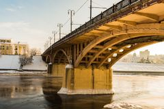 Kirov`s bridge of arch construction Belarus, view from below to the bank of the river in winter time. Kirov`s bridge of arch construction in Vitebsk Belarus Stock Images