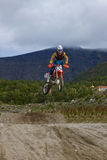 KIROVSK,RUSSIA-AUGUST 24: Races competitions on motorcycles on a. Cross-country terrain in the city of Kirovsk, Russia, AUGUSTUS 24 2013. In Russia the youth stock photography