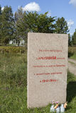 KIROVSK, RUSSIA -  SEPTEMBER 13, 2015: Photo of Memorial stone at the Memorial Ghost Village. Monument burnt village Arbuzovo. Royalty Free Stock Photo