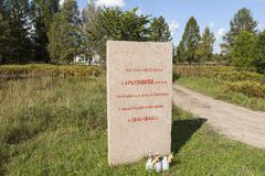 KIROVSK, RUSSIA -  SEPTEMBER 13, 2015: Photo of Memorial stone at the Memorial Ghost Village. Monument burnt village Arbuzovo. Stock Photos