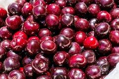 Kirschhintergrund, rote Kirschen Stockfoto