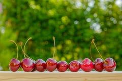 Kirschreifer roter natürlicher Hintergrund Lizenzfreies Stockbild