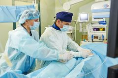Kirurglag på operationen för kärl- kirurgi Fotografering för Bildbyråer