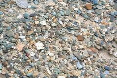 Kiselsten på sanden Arkivbild