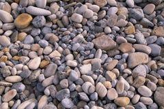 Kiselstenar på en strand i Irland Royaltyfria Foton
