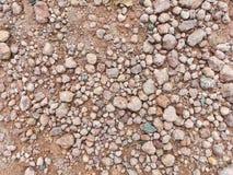 Kiselstenar på jordningen Arkivbild