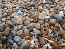 Kiselstenar på stranden royaltyfria bilder