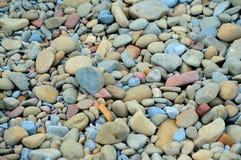 Kiselstenar på stranden Arkivfoto