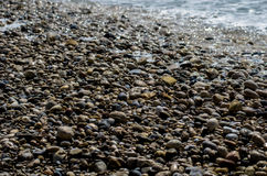 Kiselstenar på stranden, Grekland Arkivbilder