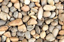 Kiselstenar som en bakgrundsbild Fotografering för Bildbyråer