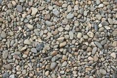 Kiselstenar stranden, stenen, kiselstenen, bakgrund, textur, vaggar, stenar, havet, modellen, grus arkivbilder
