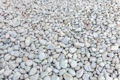 Kiselstenar texturerar, stranden vaggar många arkivbilder