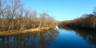 Kishwaukee River in Illinois. Trees reflect off the Kishwaukee river in northern Illinois Royalty Free Stock Image