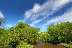 Kishwaukee River in Illinois. Fair weather clouds on a spring day over the Kishwaukee River of Illinois Royalty Free Stock Images
