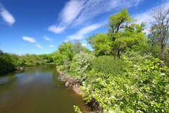 Kishwaukee River Landscape Illinois. Beautiful blue skies on a spring day along the Kishwaukee River of Illinois Royalty Free Stock Photos