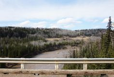 Kiskatinaw River Alaska Highway Mile 21. View of the Kiskatinaw River from the curved wooden bridge on the Alaska Highway at Historic Mile 21. Built in 1942, the stock images
