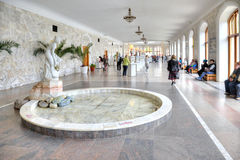 Kislovodsk. Narzan gallery. KISLOVODSK, RUSSIA - April 30.2015 : Pump-rooms with mineral water in the Narzan gallery of city. Visitors drink mineral water royalty free stock photo